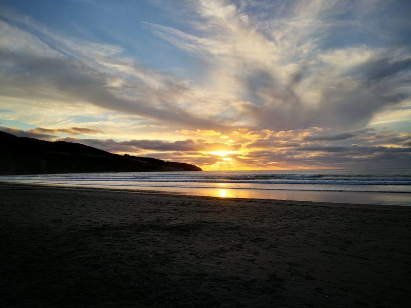 Sonnenuntergang am Ngarunui Beach